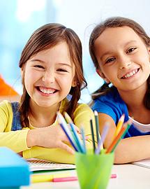Girls smiling at school