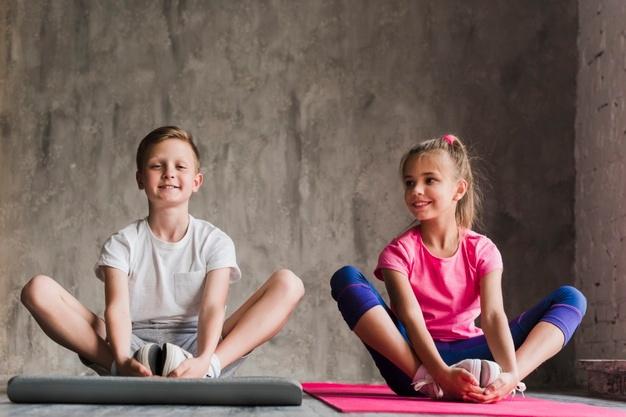 Kids sitting together exercising