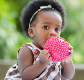 Infant playing with ball