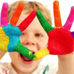 Boy finger painting