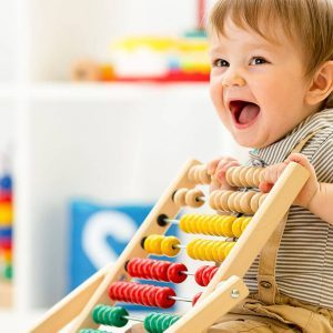 Toddler playing with toys at daycare